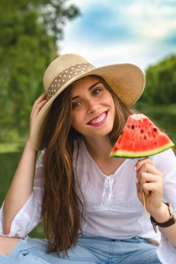happy woman with watermelon outside