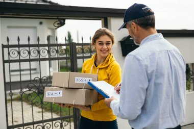 woman receiving packages from post express courier