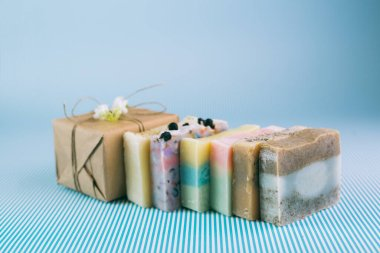 colorful handmade soaps on blue background