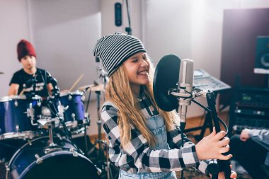 girl singing in music studio