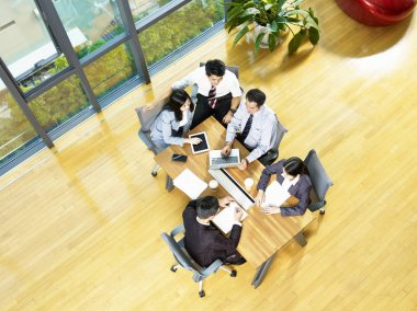 aerial view of a team of asian business men and women meeting in modern office.