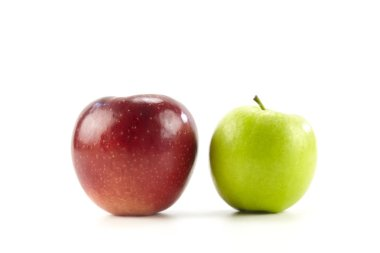 two apples one red on green isolated on white background.