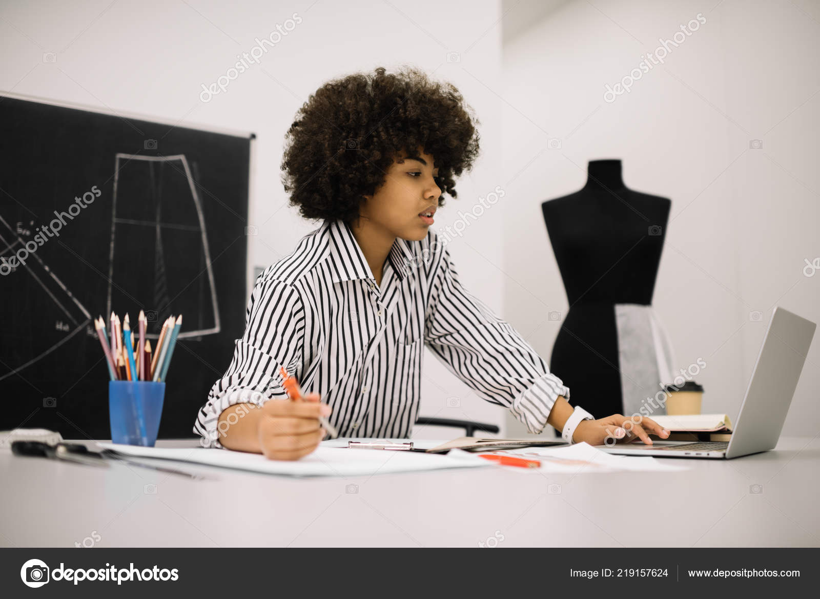 Fashion Designer Researching New Fabric Textures Online Using Laptop Computer Stock Photo C Oleksii Didok 219157624