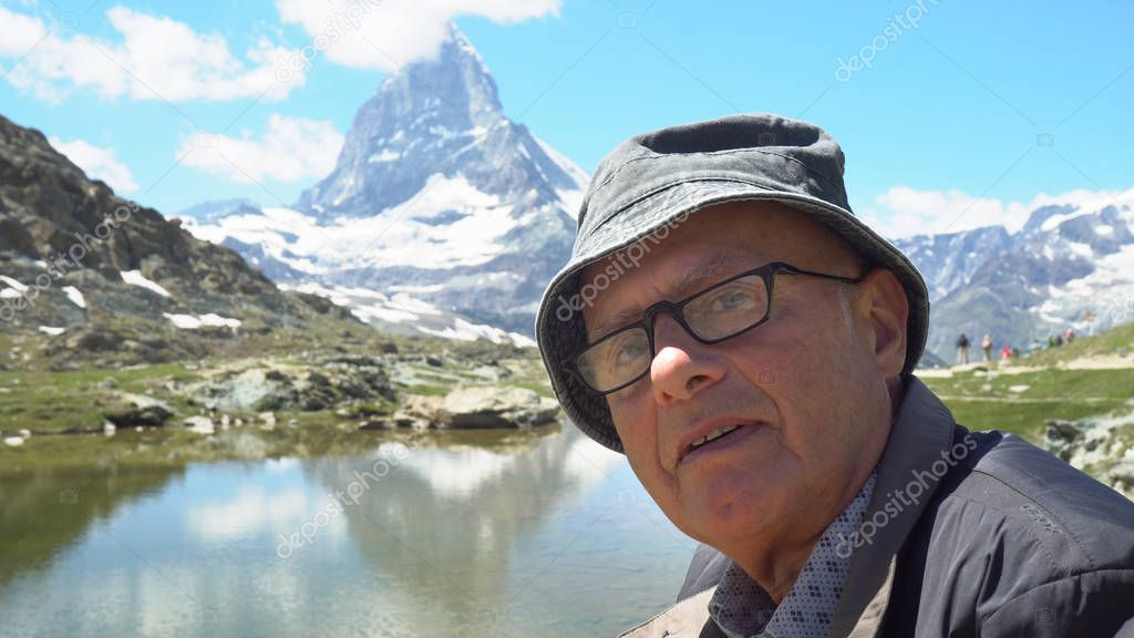 Happy Smiling Old Man Telling Stories Of Life in Mountains