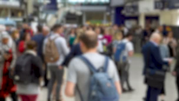 Out of Focus Blurry Crowd Of Commuters in Busy Train Station During Rush Hour
