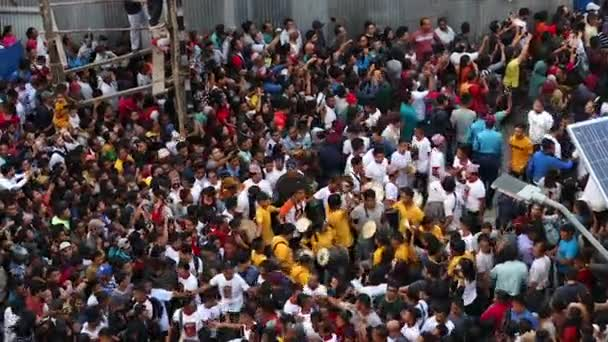 Kathmandu, Nepal - September 13 2019: Crowd of people observing and celebrating Indra Jatra Festival at Kathmandu Durbar Sqaure.