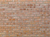 Fotografie old weathered bricks wall background