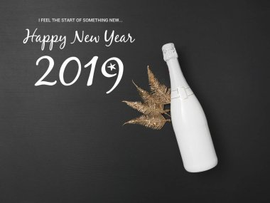 New Year background with bottle of champagne and golden decoration on black chalkboard stock vector