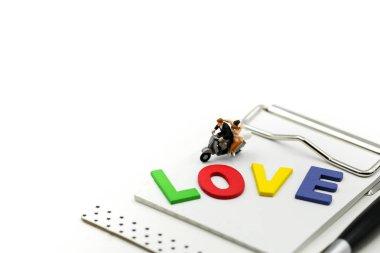 Miniature people : Loving  couple relaxing enjoying feelings tog