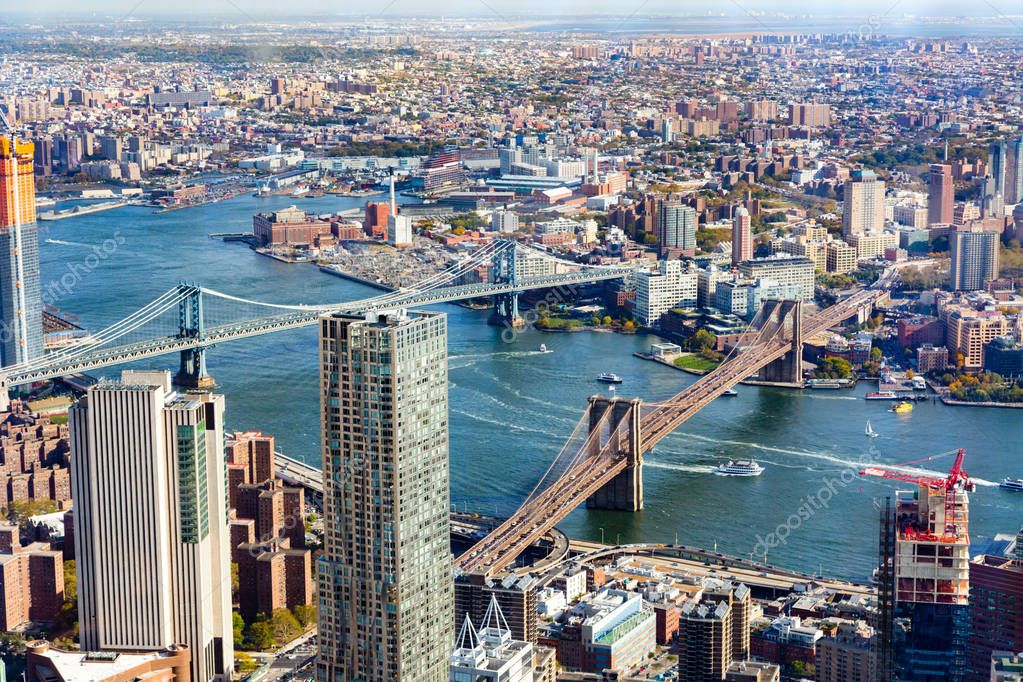 This aerial view of downtown Manhattan and Brooklyn was not taken with a drone but with a high quality camera. The Brooklyn Bridge and Manhattan Bridge can be seen as well as DUMBO Brooklyn.