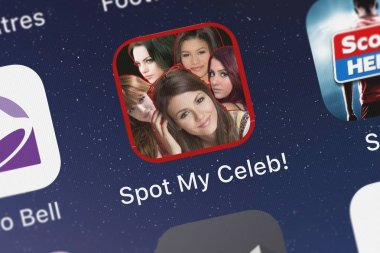 London, United Kingdom - October 01, 2018: Close-up of the Spot My Celeb - Find the Difference Celebrity Photo Quiz Game icon from Anett Meszaros on an iPhone.