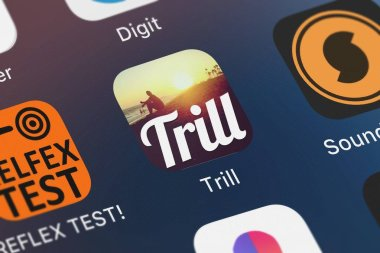 London, United Kingdom - October 01, 2018: Icon of the mobile app Trill - Text over Photo or Image from Postindustria on an iPhone.