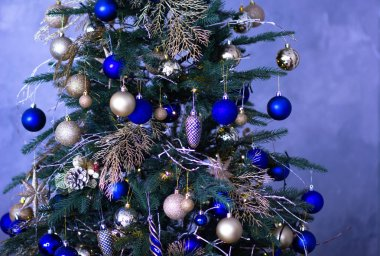 Christmas tree decorated with blue and golden balls