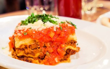 Lasagna bolognese plate, traditional recipe with tomato sauce, c