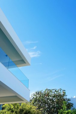 Architectural detail of a luxury modern house on the Mediterranean coast, summer holiday and real estate