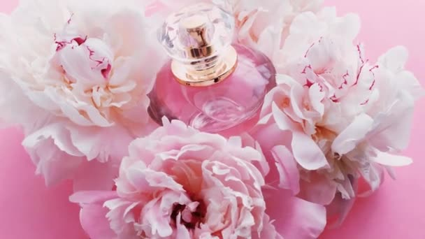 Pink perfume bottle with peony flowers, chic fragrance scent as luxury cosmetic, fashion and beauty product background