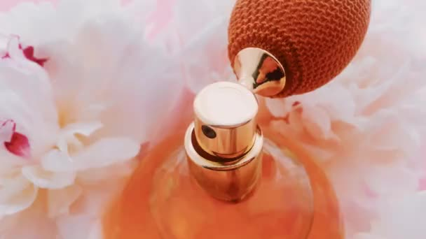 Citrus perfume bottle with peony flowers, chic fragrance scent as luxury cosmetic, fashion and beauty product background