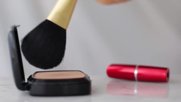 Make-up products on marble table, powder, lipstick and brush as background for cosmetic and beauty brand