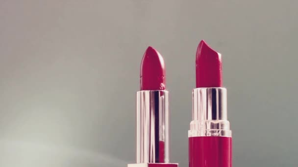 Two pink lipsticks and shining light flares, luxury make-up product and holiday cosmetics for beauty brand