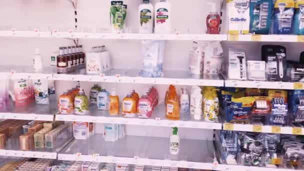 Shelves with cosmetics and beauty products in a drug store, customer service and shopping