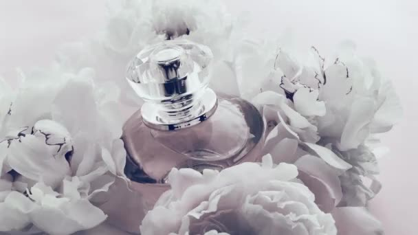 White perfume bottle with peony flowers, chic fragrance scent as luxury cosmetic, fashion and beauty product background
