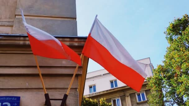 Red and white polish flag on a building in Warsaw, Poland, national independence day