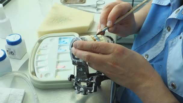 the dental technician in the dental laboratory is engaged in manufacturing metal-ceramic prosthesis