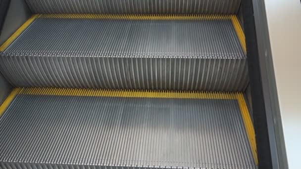 the Video of steps rising up the escalator