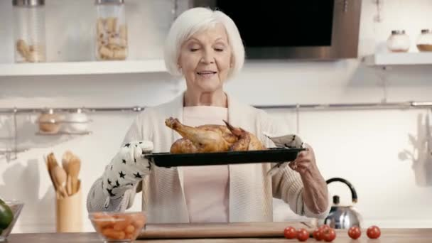 smiling woman holding tasty turkey