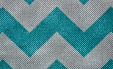 Zig zag pattern on fabric with blue and white stripes.