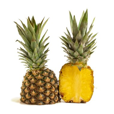 Half pineapples isolated on white background. Side view.