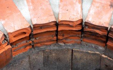 Cracked and broken hollow ceramic brick in old brickwork, closeup.
