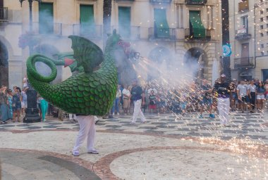 Vilanova i la Geltru, Barcelona, Spain - July 26, 2018. Encounter of dragons in Fire-run in the celebrations of the festival
