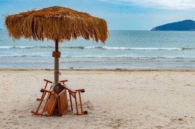 sun loungers and umbrella on a beach