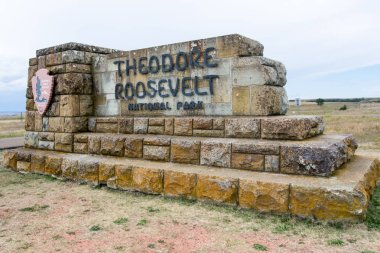 AUGUST 28 2018 - MEDORA, ND: Sign for Theodore Roosevelt National Park along I-90 in the midwest in summer