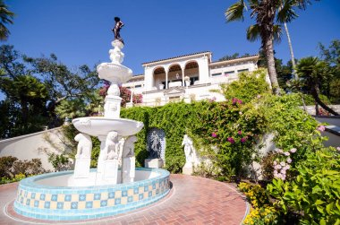 San Simeon, California - August 7, 2018: Exterior view of the Hearst Castle against a bright blue sky
