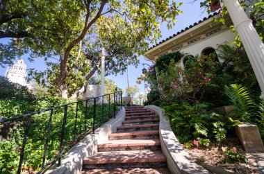 San Simeon, California - August 7, 2018: Beautiful exterior staircase in a garden outside the Hearst Castle, on the grounds
