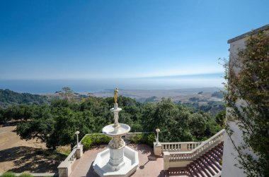 San Simeon, California - August 7, 2018: Famous golden girl statue overlooking the coastal mountains at the Hearst Castle
