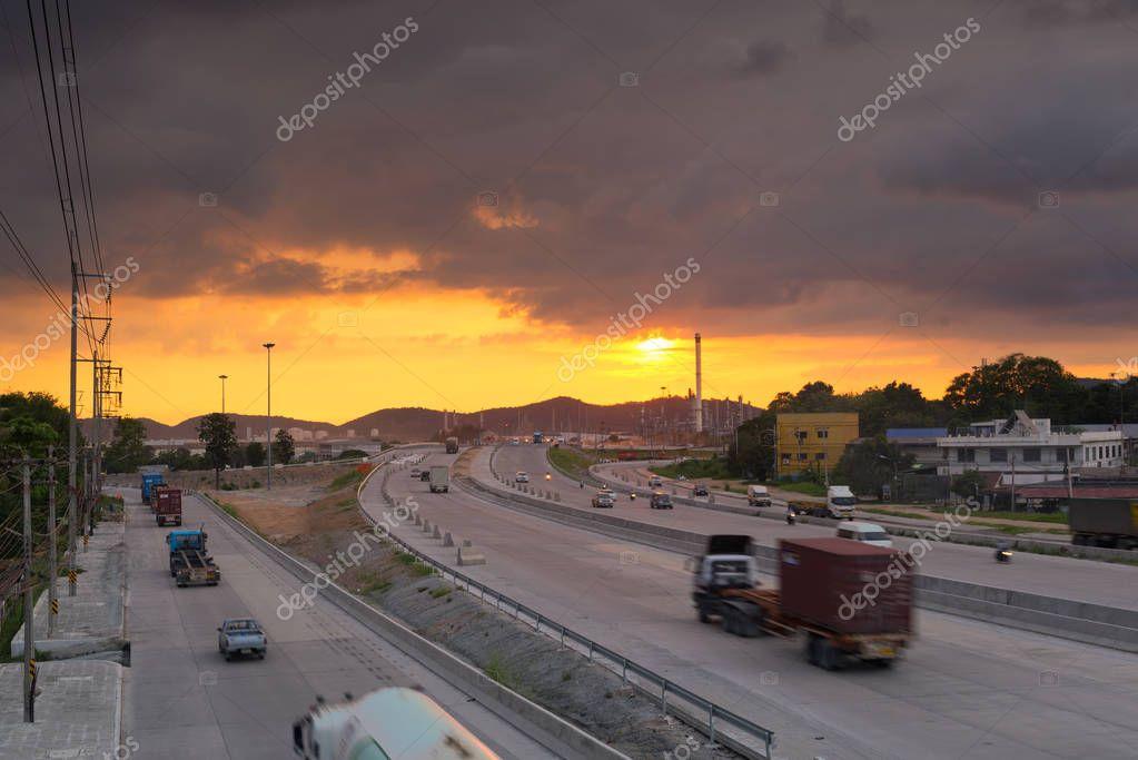 orange sunset sky, road with cars