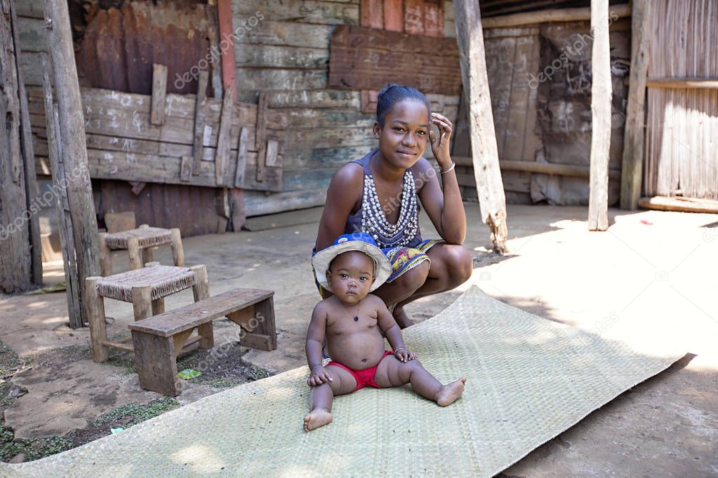 Young mother with baby,   Madagascar