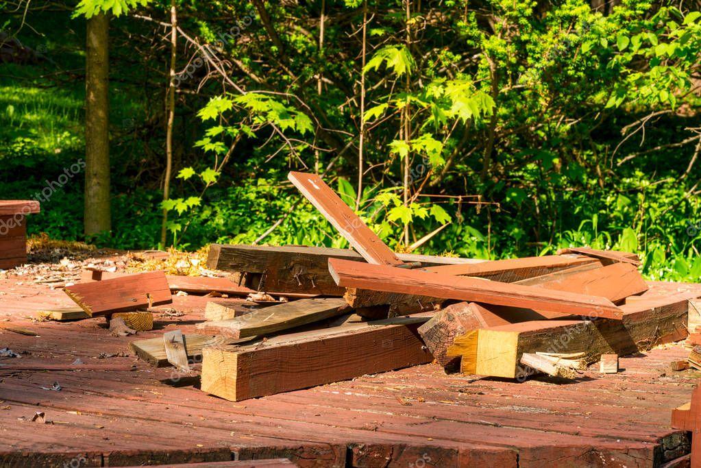 Piled-up debris from a backyard deck demolition in progress