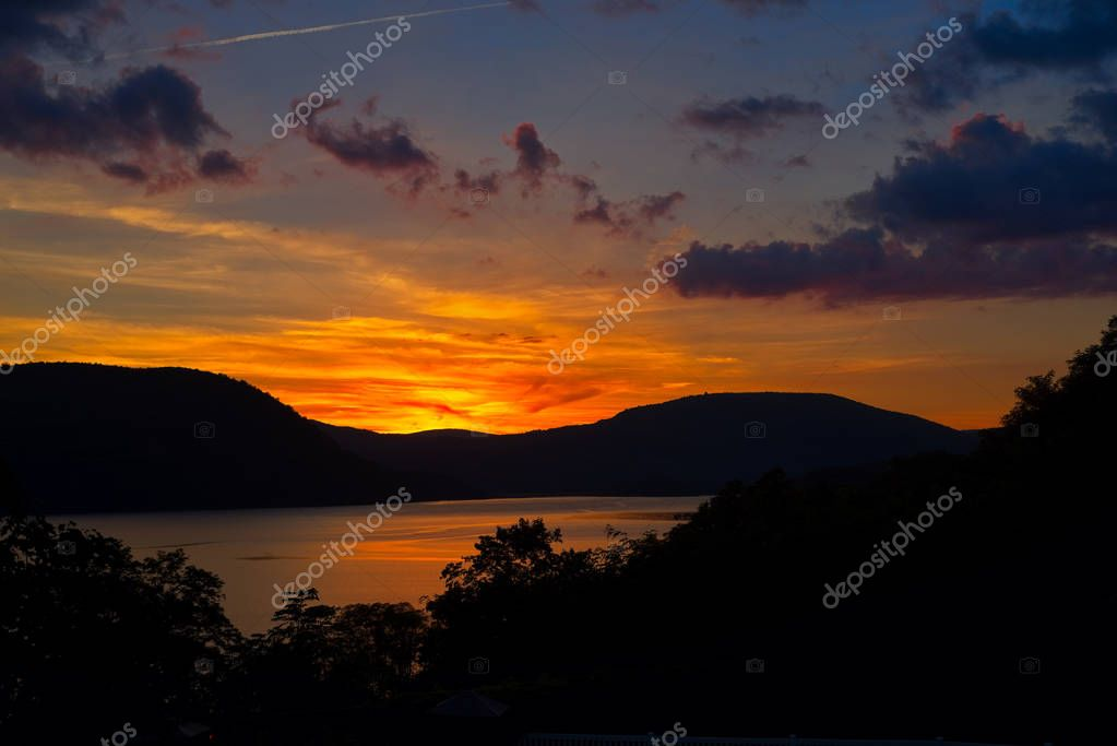 The setting sun casts a brilliant glow over the Hudson River at Peekskill New York