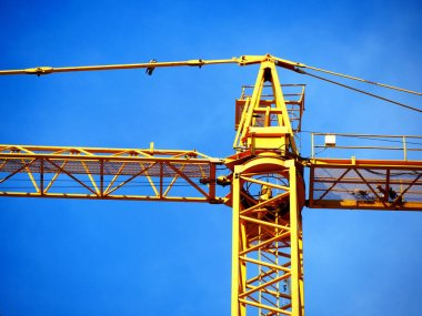 Crane. Self-erection crane near concrete building. Construction