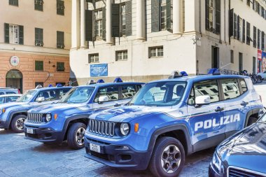 MILAN, ITALY - JUNE 27,2018:Italian Police Blue Cars with Big Writing POLIZIA Parked in Front of the Police Office
