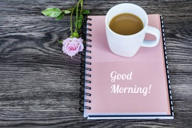 Notebook,Rose and Cup of Coffee for Good Morning .Spring Morning Concept