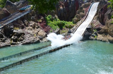 SALOU, SPAIN - MAY, 19,2017: Falling Down Water Ride with People at the Amusement Park Port Aventura near Barcelona.Tutuki Splash water ride is  in the Polynesia section of the park