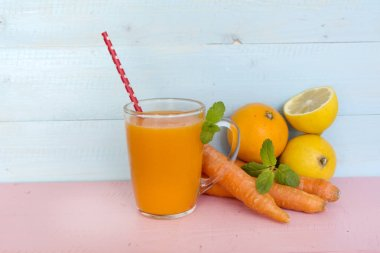 orange smoothie juice with carrots lemon and orange . Healthy life concept.