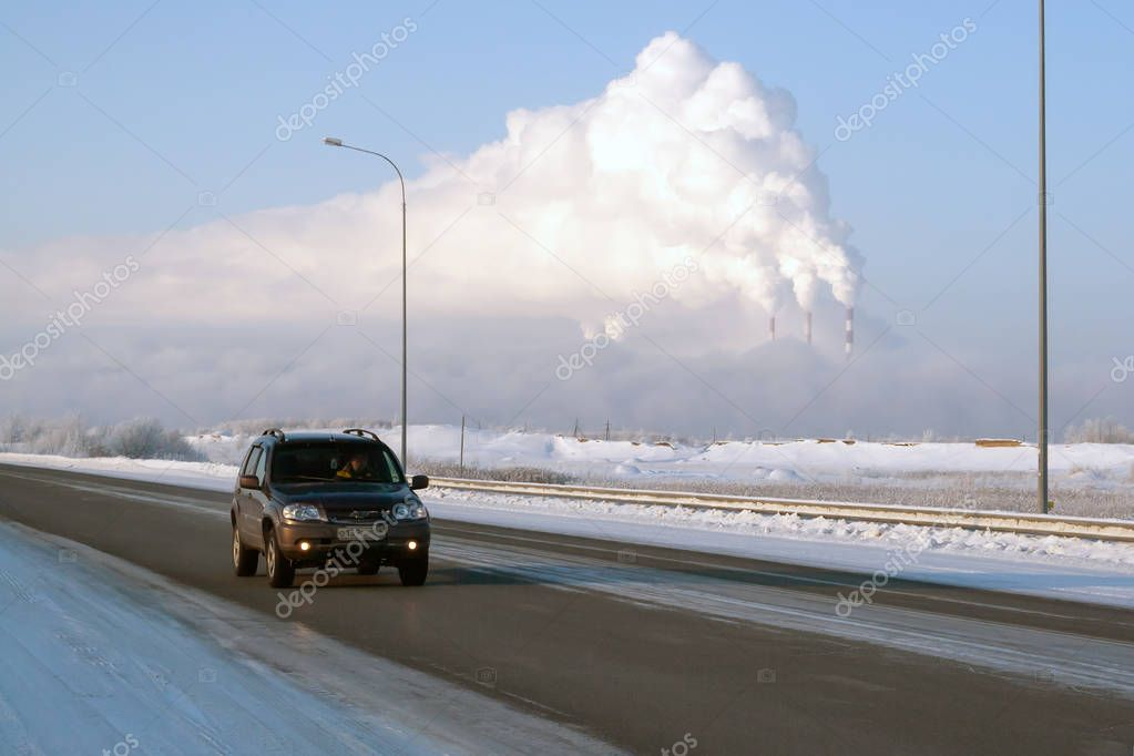 Russia, Surgut, November 29, 2018: view of Surgut GRES-2 from Nizhnevartovsk-Surgut highway, on a frosty winter day. The pipes of thermal power plants smoke beautifully.