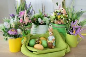 Easter eggs with spring flowers on table