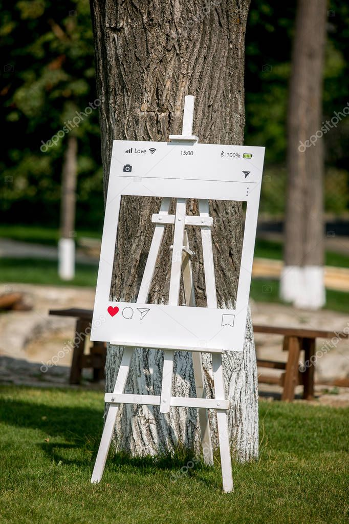 Summer outdoor wedding ceremony decoration. Photo frame for guests, social networks concep, vertical view